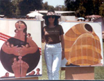 Roberta Farrington and two of her  Southwest women paintings